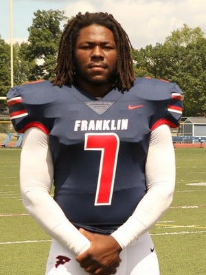 Livonia Franklin senior running back Isaac Moore was honored for his big game Oct. 13 against Grand Blanc.