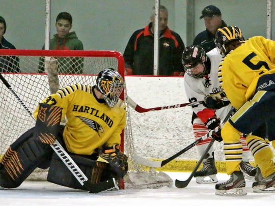 Goalie Aaron Neighbor, left, stood tall in the net for the Eagles, who fell in the KLAA title game for the third consecutive year.