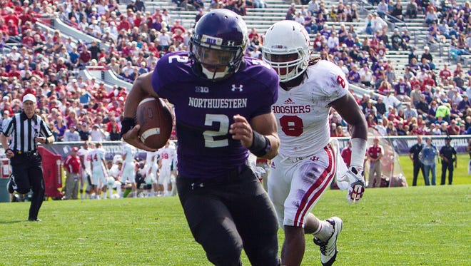 Northwestern's Kain Colter (2) runs for a touchdown against Indiana during the second quarter of an NCAA college football game in Evanston, Ill. on Sept. 29, 2012.