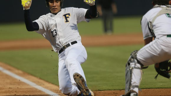 Faith's Pablo Cortes slides safely into home to score the team's first run Thursday against Monahans.