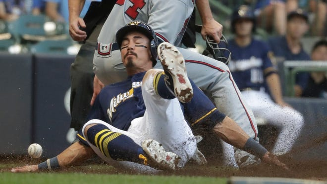 Tyler Saladino scores past the Braves' Max Fried during the second inning Thursday night.