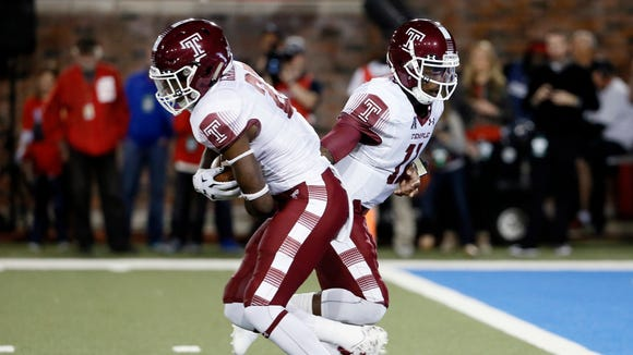 Owen alum Jager Gardner takes a handoff from Temple quarterback P.J. Walker on Friday in Dallas.