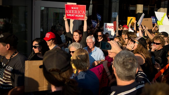 Donald Trump supporters and protesters mingle outside the U.S. Cellular Center before Trump's rally Sept. 12.
