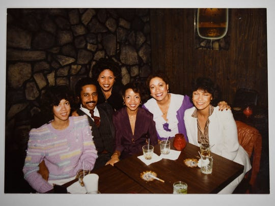 In the late '70s, Dwayne Tucker and his girlfriend, Carmen, left, and her friends and family at the Wall Street club he started in North Nashville.