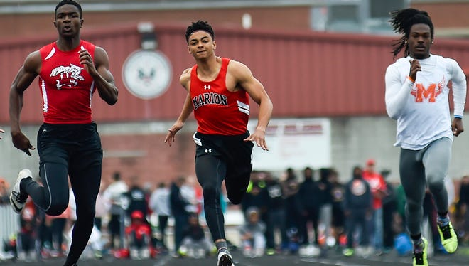 Marion Harding's Nick Middlesworth powers through the last few yards of the 100-meter dash during the Marion Harding Night Invitational last year. Middlesworth returns to lead the Harding sprinters again.