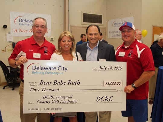 Delaware City Refining Company donated $85,000 to local charities in 2015. Pictured (left to right) are Glenn Nichols, Bear Babe Ruth League board vice president; state Rep. Valerie Longhurst; Delaware City Refinery manager Jose Dominguez; and Bear Babe Ruth board member, Chalie Lane.