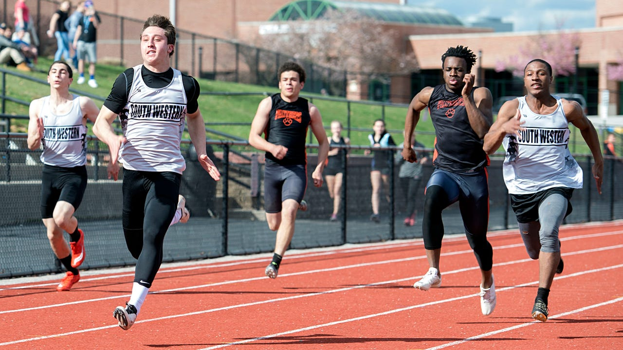 South Western sprinters Drew Hartlaub and DeLunche Shaw discuss competing against each other in the 100-meter dash.
