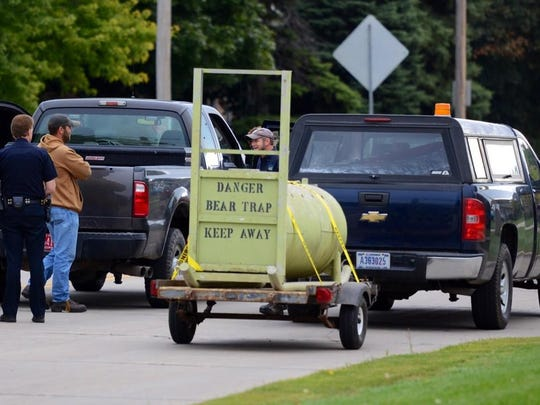 A bear trap arrived at the scene on Green Bay's west side at about 9:20 a.m. Thursday.