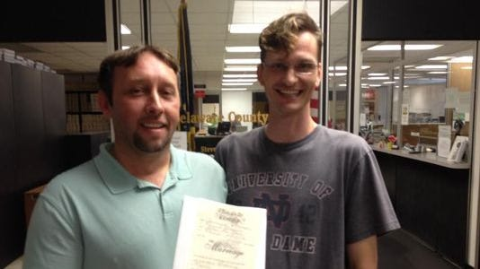 Jeremy and Jathan Patterson show their marriage license outside the Delaware County clerk's office shortly after getting married on June 26, 2014.
