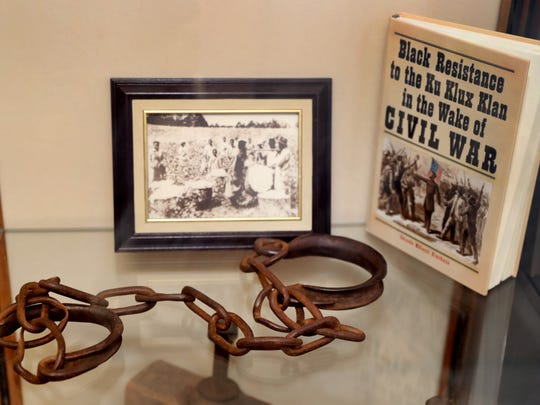 Actual slave shackles and chains are on display at
