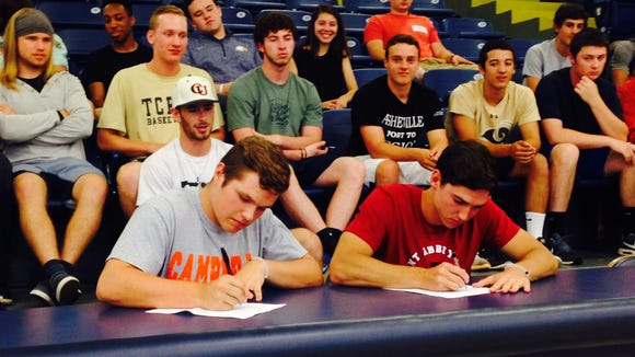Roberson seniors Trenton Davis, left, and Nate Fore have signed to play college baseball.