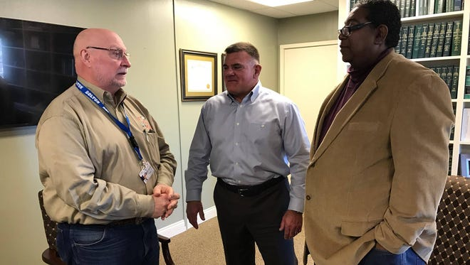 (From left) Bolton Principal Clovis Christman, Rapides District Attorney Phillip and Terrell and Clifton Spears, who heads the juvenile division of the District Attorney's Office, discuss efforts to address truancy in Rapides Parish schools.