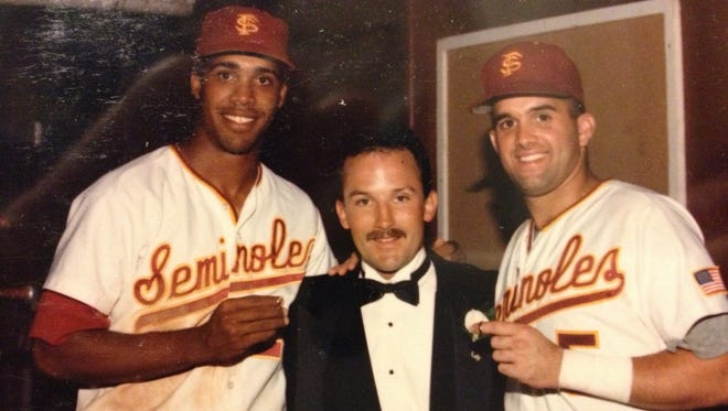 Pedro Grifol (right) served as a ring bearer with teammate Eduardo Perez as Chip Baker's wedding in 1991.