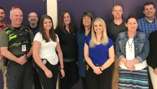 """Pictured are panel members for Two Rivers Public School District's """"Let's Talk"""":First row (from left): Middle School Resource OfficerMonty Greene; patrol officer Megan Klumpyan; detective Lt. Melissa Arps; Two Rivers High School Associate PrincipalJeanne Wall; and Koenig Principal Dana McLinn; and back row (from left): elementary school resource officerJake Glaser; Two Rivers High School Resource OfficerJason Zipperer; Pupil Services Director Bridgett Klein; District AdministratorLisa Quistorf; Magee Principal Chad Bauknecht; and LBC PrincipalTim Wester."""