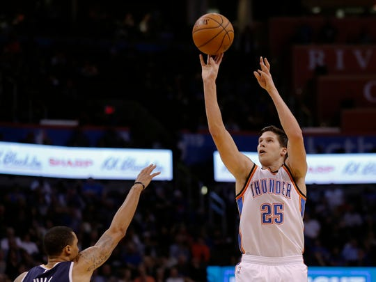 Oklahoma City Thunder forward Doug McDermott (25) shoots over Utah Jazz guard George Hill (3) during the first half of an NBA basketball game in Oklahoma City, Tuesday, Feb. 28, 2017. (AP Photo/Alonzo Adams)