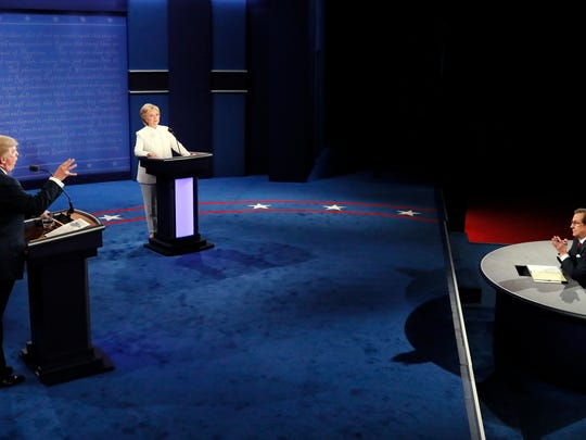Moderator Chris Wallace, of FOX News, questions Democratic presidential nominee Hillary Clinton and Republican presidential nominee Donald Trump during the third presidential debate at UNLV in Las Vegas, Wednesday, Oct. 19, 2016. (Mark Ralston/Pool via AP)