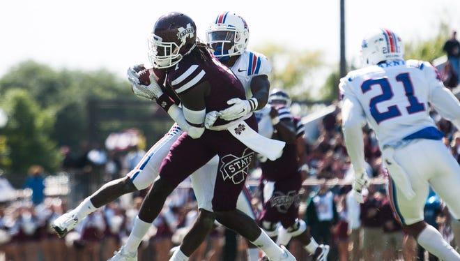 Louisiana Tech safety Xavier Woods (7) said Monday the Bulldogs won't take a step back in 2016.