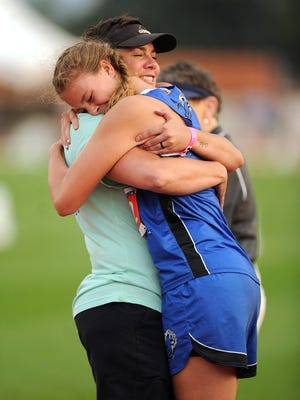 Westbrook's Miranda Goswick gets a hug from her coach Chrissy Morris after Goswick's win in the Class 1A girls high jump during the UIL state track and field championships on Thursday, May 11, 2017, at Mike A. Myers Stadium in Austin. The win was believed to be the first state championship in any sport, boys or girls, for Westbrook.
