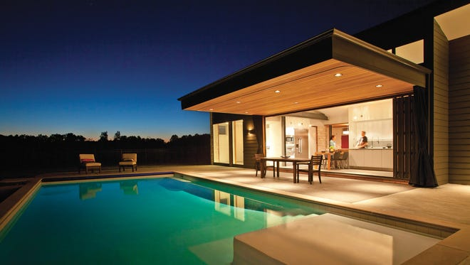 A wall of windows overlooking a tranquil pool provides homeowners access to outdoor scenery without being exposed to elements.