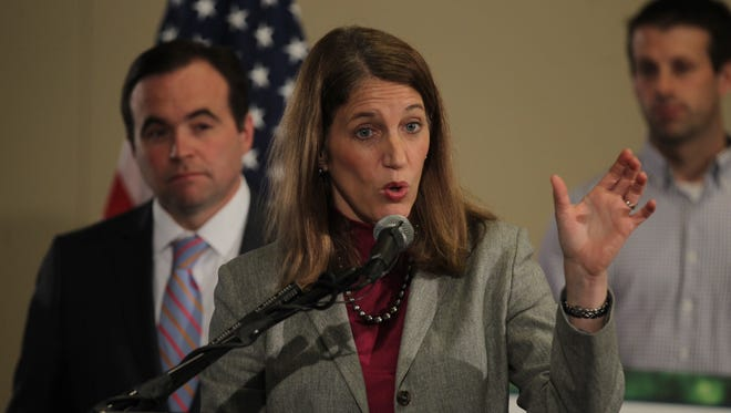 Health & Human Services Secretary Sylvia Burwell talks about the Affordable Care Act on Thursday. Cincinnati Mayor John Cranley is on the left.