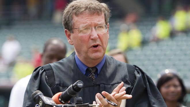 Larry McKinney, U.S. District Court Judge, presides over a brief naturalization ceremony before the days' Indianapolis Indians game at Victory Field, Indianapolis, IN, Tuesday, June 23, 2010.