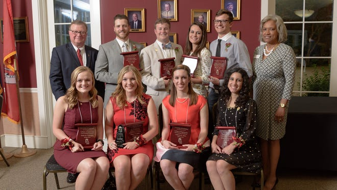 Eight UL Lafayette seniors have been recognized as Outstanding Graduates. Seated from left, are: Emily Covington, College of Liberal Arts; Ashley Duhon, Ray P. Authement College of Sciences; Catherine Ledet, College of Engineering; Celeste Licciardi, College of the Arts. Standing, from left, are: Dr. Joseph Savoie, UL Lafayette president; Eric Carter, University College; Philip McMahon, B.I. Moody III College of Business Administration; Gabrielle Gallien, College of Education; Jake Savoie, College of Nursing and Allied Health Professions; and Angela Morrison, president-elect for the UL Lafayette Alumni Association.