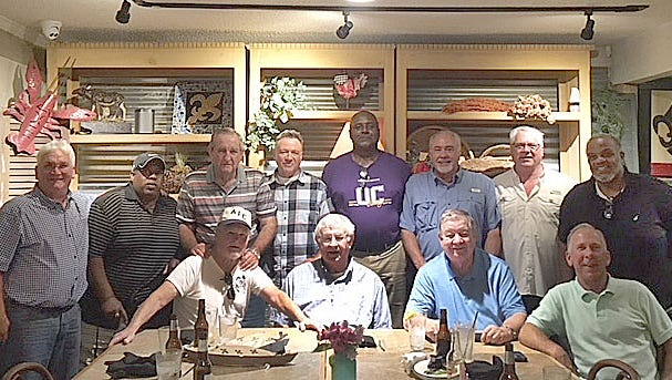 Former Opelousas Catholic football coaches and longtime school athletic booster Billy Jarrell hosted a mini-reunion for the 1974 state championship football team at Josephine's on Tuesday night in Sunset. Former head coach Mickey Mills and assistants Armand Castille and Johnny Bourque are seated with Jarrell on the front row. Ex-players who attended and who are included in the photo are Tommy Diesi, Wendall Mason, Darrell Mason, John Torian, Tim Thibodeaux, Russell Dupuis, Ken Wagley, Wayne Benson and Yves Prince.