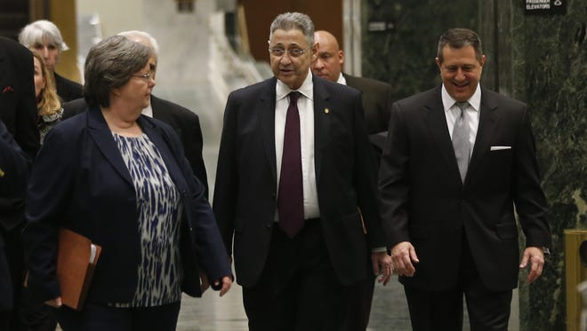 Assembly Speaker Sheldon Silver, D-Manhattan, center, and Assembly Majority Leader Joseph Morelle, D-Rochester, right, walk though the Legislative Office Building on their way to the Capitol on Monday in Albany. Silver was fighting to keep his grip on power Monday amid widening calls for his resignation in the wake of federal corruption charges.