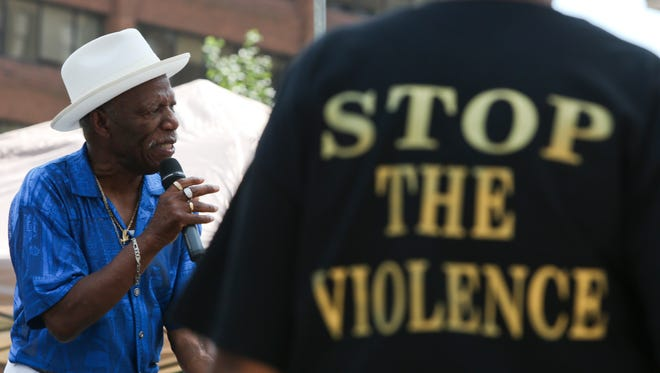Nathaniel Johnson of the Mighty Men performs during a remembrance ceremony for victims of violence in Wilmington's Rodney Square Saturday.