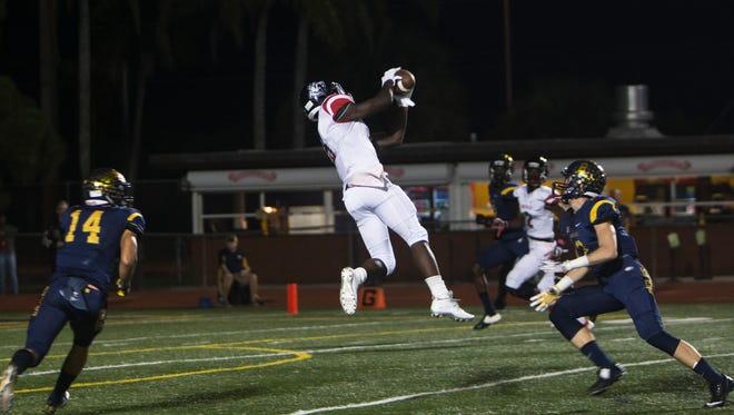 South Fort Myers running back Quan Dorris, #9, jumps to catch the ball during their matchup against the Naples Golden Eagles at Staver Field on Friday, Oct. 21, 2016 in Naples, Florida. The Wolfpack defeated the Eagles 42-35.