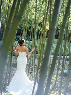 Heather Bullara Quirk poses for photos at Rip Van Winkle Gardens before her wedding in April.