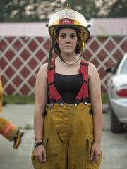 Miranda Currier, 19, is a volunteer with the Chenango Bridge Fire Department.