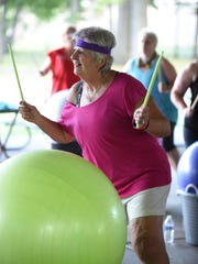 Canton resident, Roma Sena was all smiles during a cardio-drumming class.