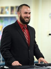 Abe Tawfeek speaks as the new Richmond High football coach Wednesday at Richmond Community Schools' board meeting.