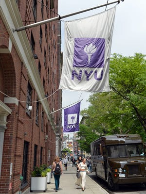 Flags fly from a New York University building in New York.