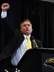 Southern Miss football coach Jay Hopson leads supporters