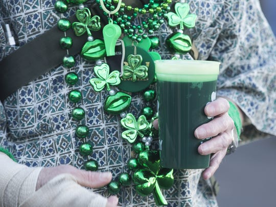 Mark Manypenny laughs with his beer in the morning at Rosie McCaffrey's during St. Patrick's Day in Phoenix, Ariz. on Thursday, March 17, 2016.