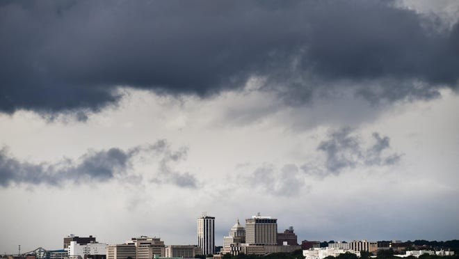 Dark clouds roll across the Peoria skyline from an approaching front, viewed from East Port Marina in East Peoria.