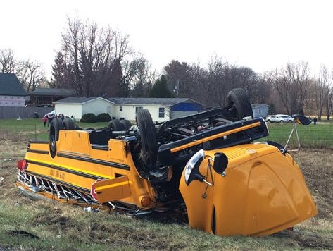 A school bus carrying Griffith High boys basketball team is seen overturned in Demotte, Ind., Saturday, March 19, 2016. The bus rolled over on Interstate 65 on the way to Saturday's semifinal game against Marion at Lafayette Jefferson.