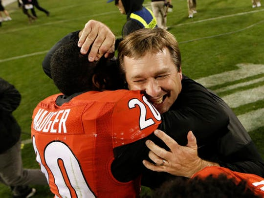 Georgia head coach Kirby Smart celebrates with safety Quincy Mauger (20) after defeating Auburn 13-7 in an NCAA college football game Saturday, Nov. 12, 2016, in Athens, Ga. (AP Photo/John Bazemore)