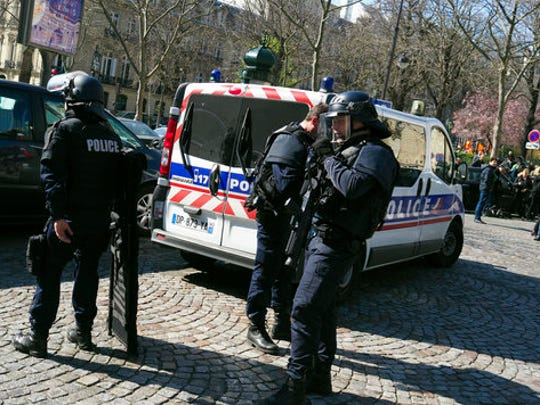 French police officers take position after letter bomb