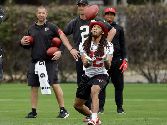 Atlanta Falcons cornerback Jalen Collins (32) fields a ball in front of quarterback Matt Ryan (2) during a practice for the NFL Super Bowl 51 football game Friday, Feb. 3, 2017, in Houston. Atlanta will face the New England Patriots in the Super Bowl Sunday. (AP Photo/Eric Gay)