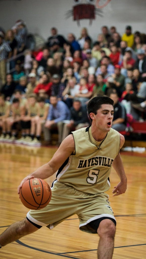 Josh Cottrell drives to the basketball during a game