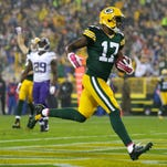 Green Bay Packers wide receiver Davante Adams scores a touchdown in the second quarter against the Minnesota Vikings at Lambeau Field on Oct. 2, 2014.