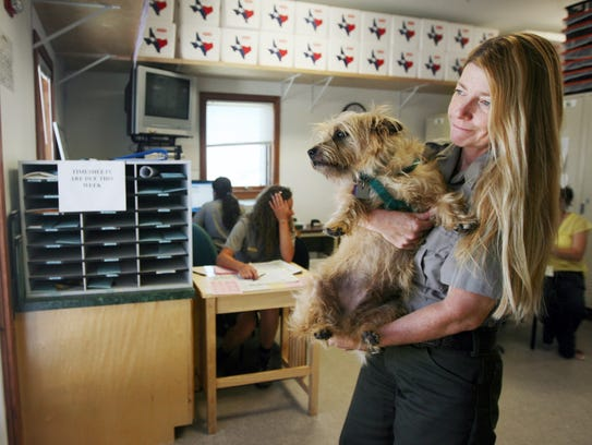 Donna Shaver, the Division of Sea Turtle Science and Recovery chief, holds her dog Ridley Ranger away from the door as a visitor comes to the entrance of the turtle lab Tuesday, April 21, 2009 at the Padre Island National Seashore headquarters.