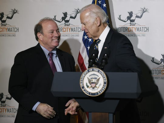 Mayor Mike Duggan, left, and then-Vice President Joe Biden share a moment Jan. 10 after Biden attended the Motor City Match awards.