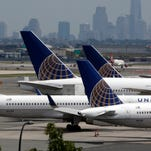 United Airlines jets are parked on the tarmac at Newark Liberty International Airport on July 22, 2014.