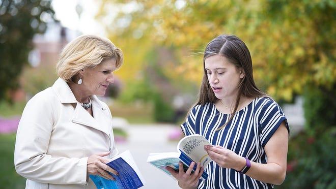 Donna Baker (left), Adrian College associate professor in accountancy and MS in Accountancy Graduate Program liaison, speaks with AC senior student Megan Abela.