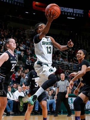 Michigan State's Morgan Green (13) puts up a driving layup against Northwestern's Christen Inman, left, and Nia Coffey, right, Sunday, Jan. 10, 2016, in East Lansing, Mich. Michigan State won 74-51.