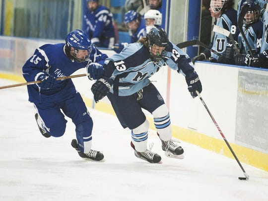 MMU's Jackson Wright (13) skates past Missisquoi's Mason LaFountain (15) during the boys hockey game between Missisquoi Valley and Mount Mansfield at the Essex Skating Facility on Saturday Dec. 5 in Essex.